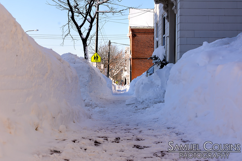 Giant snow banks coming down Congress St on Munjoy Hill