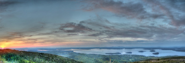 Captured from a top Cadillac Mountain, the sun sets over Frenchman's Bay, at Bar Harbor.  In the foreground are the Porcupine Islands.