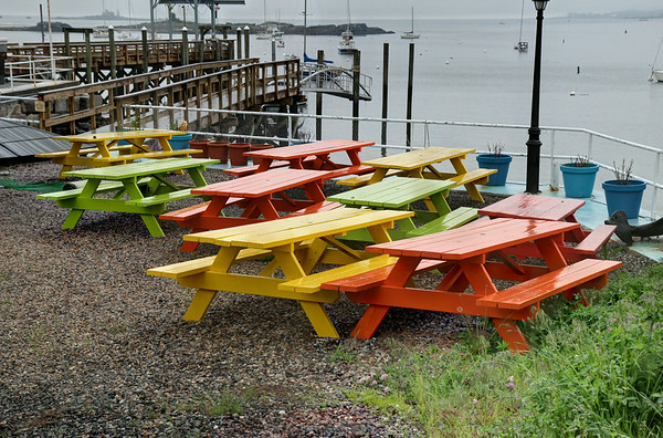 Although all colors in the spectrum are not represented, these colorful picnic tables set a colorful tone, on a drab, soggy day.