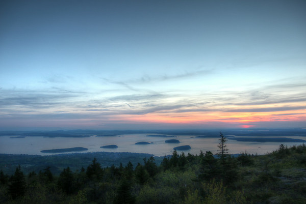 A sunrise view from atop Cadillac Mountain in Arcadia National Park,looking out over Bar Harbor, Frenchman's Bay, and the Porcupine Islands.