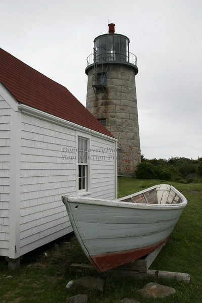 "Monhegan Lighthouse, Boat and Building,Maine,"" color photo"