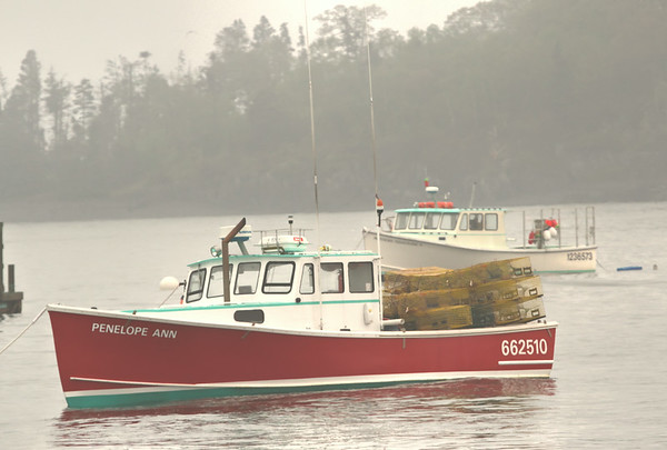The Penelope Ann, with Lobster cages stacked, ready to head out from Bar Harbor, ME.