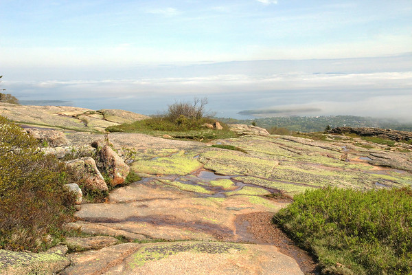 From this vantage atop Cadillac Mountain, you can see the fog and low hanging clouds over Frenchman Bay.