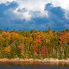 Fall foliage with storm clouds brewing over Bailey Point, Phippsburg, maine, October