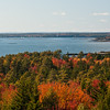 view from Robinson's Rock, also known as The Bumper, PHippsburg, Maine, looking west to Yarmouth and the Portland city skyline, autumn foliage, Maine scenic panoramic vista