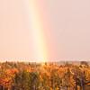 rainbow over Bailey Point, Phippsburg Maine with autumn foliage, Totman Cove