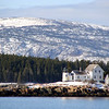 Mark Island and Winter Harbor Light with Cadillac Mountain looming in the background.