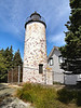 In 1828 a 26 foot stone tower with an octagonal lantern was erected costing $2,944 on the highest point of the island to help mark the western entrance to Frenchman's Bay.  It was equipped with 10 oil lamps with reflectors and exhibited a fixed white light.