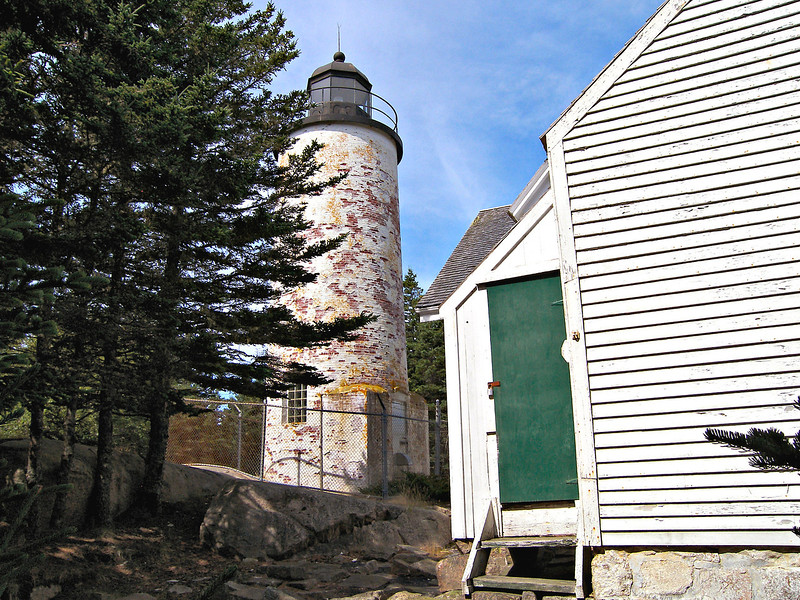 In 1855 Congress finally appropriated $5,000 to have the Baker Island Light rebuilt.  A new 43 foot brick cylindrical whitewashed tower was erected with a focal plane of 105 feet above sea level.  In addition a 1½ story attached wooden Keepers residence was built.