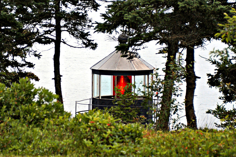 The Fifth Order Fresnel lens was upgraded to a Fourth Order lens in 1902 and remains today. Originally a red chimney was placed on the lamp to provide its red color. Currently a red acrylic shade around the lens provides the red color.