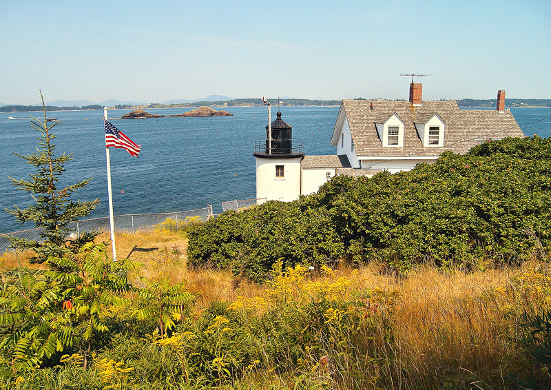 By the 1850's the Keepers house and the tower were in a dilapidated condition and plans were made to replace the station buildings.  In 1857 the old structures were demolished and a new 1½ story wood framed dwelling was built with an enclosed walkway attached to a new lighthouse tower.