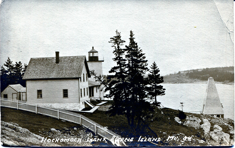 An old postcard view of the Burnt Coat Harbor Light Station showing the old fog bell tower.