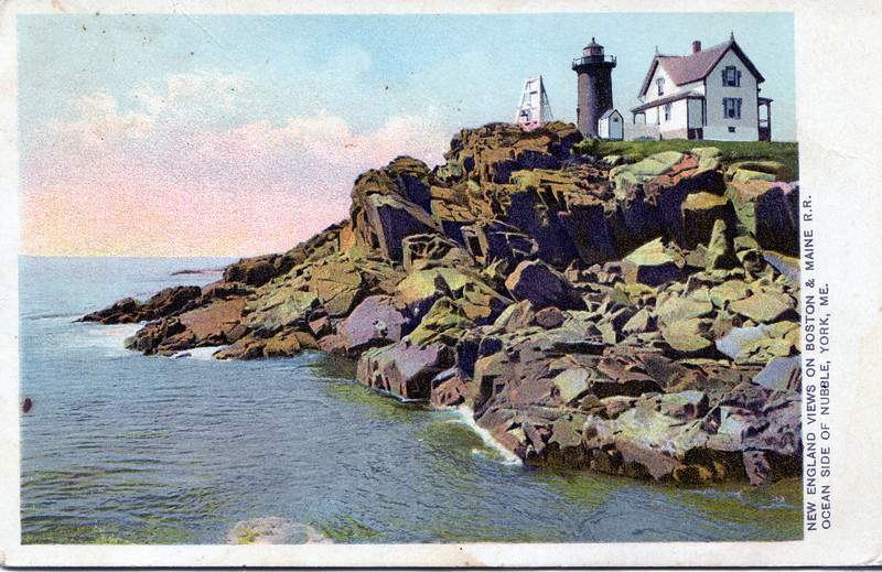 An old pre-1902 postcard image of the Nubble showing the open frame fog bell tower and the lighthouse painted a reddish brown.
