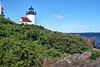 Gault built a 20 foot lighthouse tower from rubblestone found on the island. The tower was topped by a lantern which was fitted with 8 oil lamps with 14 inch reflectors provided by Joseph Berry of Georgetown, Maine for a cost of $650