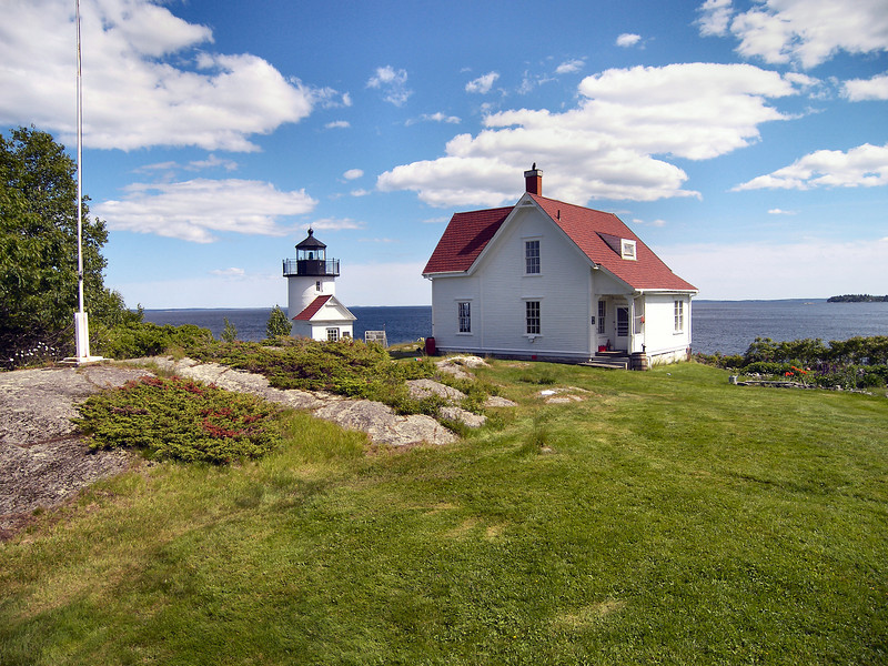 In an attempt to address the leaky tower the Lighthouse Establishment had the tower covered in an octagonal wood sheathing in 1855.