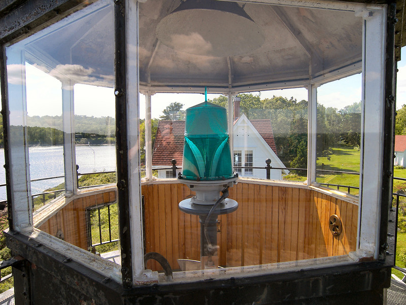 The lantern was equipped with a Fourth Order Fresnel lens replacing the 8 oil lamps with reflectors in 1855. The lens was removed when the light was automated. Currently a 300mm solar powered optic provides the light. The wood in the lantern room was recently restored by caretaker Connie Conover.