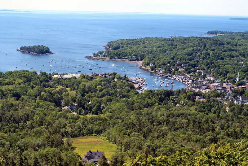 *A view of Camden Harbor and Curtis Island from the top of Mount Battie*<br /> In 1836 Keeper H.K.M. Bowers lit the fixed white light of the Negro Island Light for the first time.