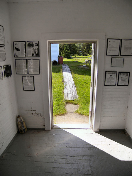 A view from inside the work room attached to the tower. Copies of historical documents and news articles relating to the lighthouse are hung on the walls.