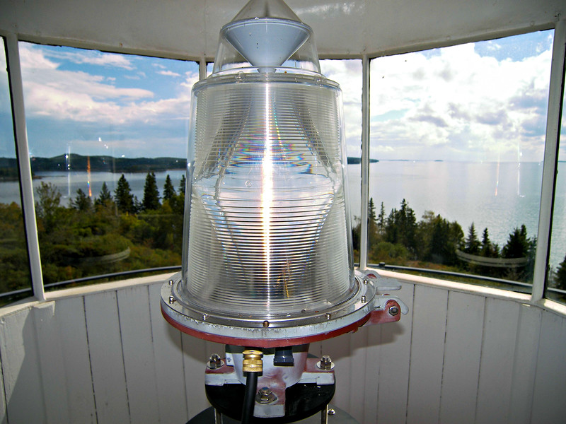 In 1857 the Light House Board considered discontinuing the Dyce Head Light.  Instead in 1858 the lantern received a new 4th Order Fresnel lens and the leaky tower was covered with wooden siding and connected to the dwelling by a covered wooden walkway.  The new lens was visible for 17 miles.