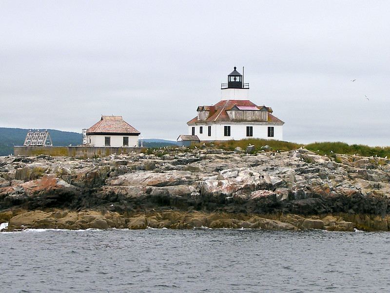 A square brick tower in the center of a 1 story wooden dwelling was built during the summer of 1875.  The light station went into service on November 1, 1875. The lantern held a 5th Order Fresnel lens exhibiting a red fixed signal.