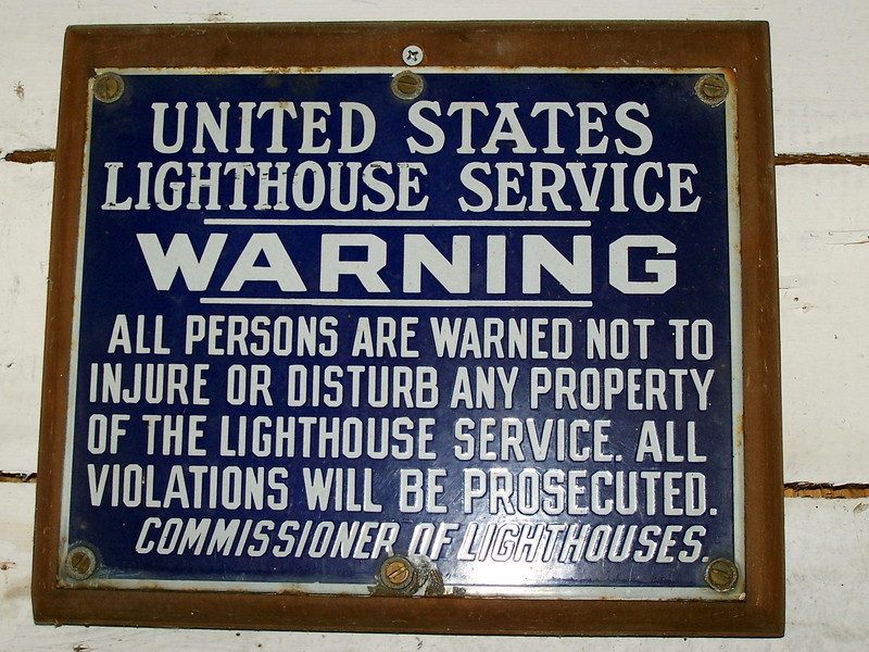 An old Lighthouse Service sign warning visitors not to disturb lighthouse property