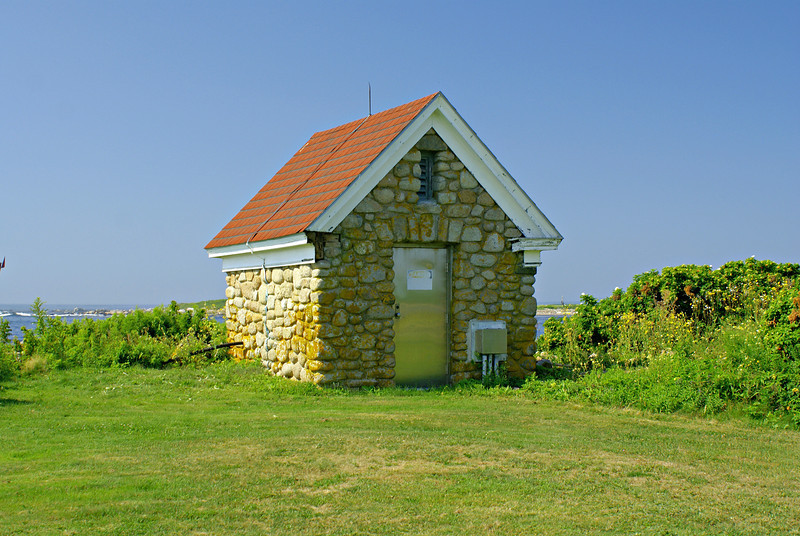 The stations oil house was built in 1907 and is made of stone.  I have seen other similar stone oil houses at lighthouse stations in Rhode Island.  The oil house had its woodwork repaired in 2011.