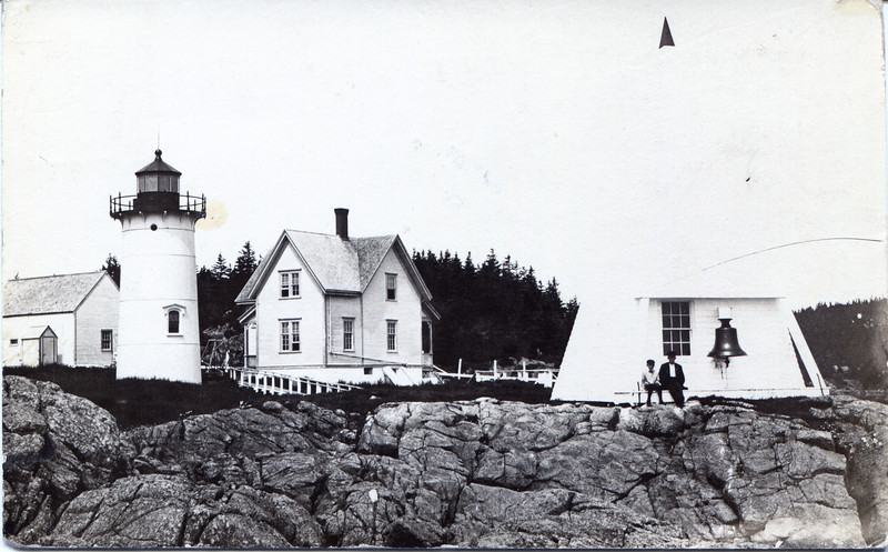 Turn of the century postcard view of the Little River Light Station showing the fog bell tower and barn