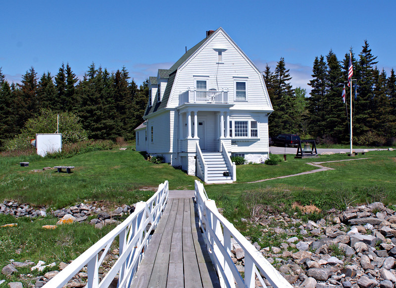 The Keepers house was badly damaged when it was struck by lightning in 1895.  The Skinner's moved into the workshop building until a new Colonial Revival Keeper's house was completed in 1896.  This is the same residence currently at Marshall Point.