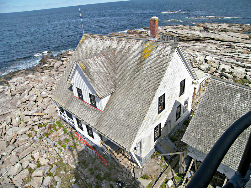 In 1893 the old stone dwelling was finally torn down and replaced with a wood framed Colonial duplex.  It had been constructed at the Light House Service's Portland Depot, then taken apart and shipped to the Rock for reconstruction.  This is the dwelling which exists on the Rock today.