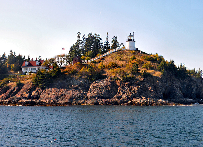 A view of the light station from the water. The Owls Head Light can be viewed traveling on the ferries from Rockland to Vinalhaven, North Haven & Matinicus