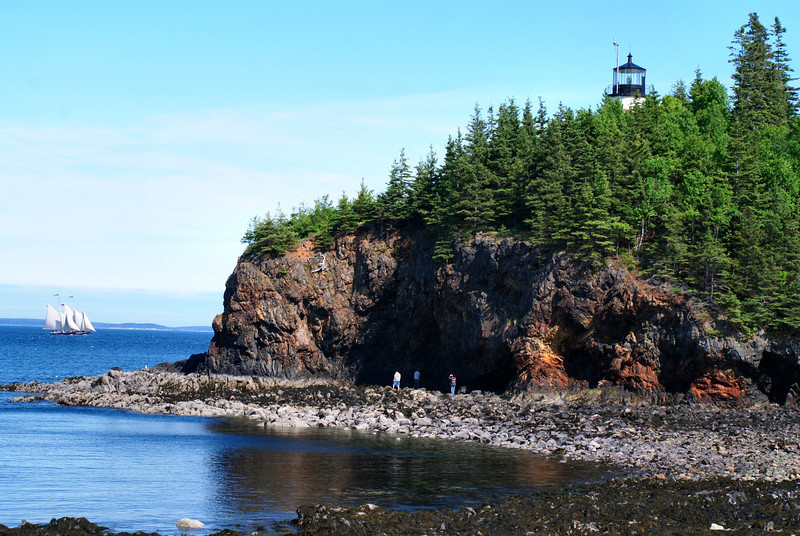 A schooner slides by the Owls Head Light evoking a feeling of earlier times.