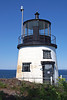 The characteristic of the lantern is a fixed white light.  It is visible for a distance of 16 miles.