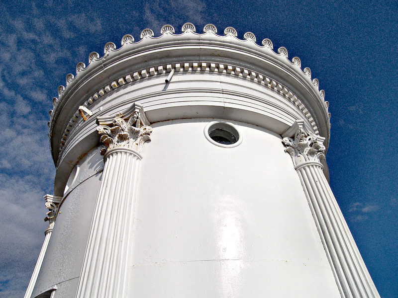 The new 24 foot light tower was completed in 1875 and was modeled after the Choragic Monument of Lysicrates that was built in 300 B.C. in Greece. It featured six fluted columns (which cover the joined sections of the iron light) and palmettes decorating the roof and lantern. These distinctive features make this a one-of-a-kind lighthouse tower. The interior of the light is lined with brick for additional stability and insulation.