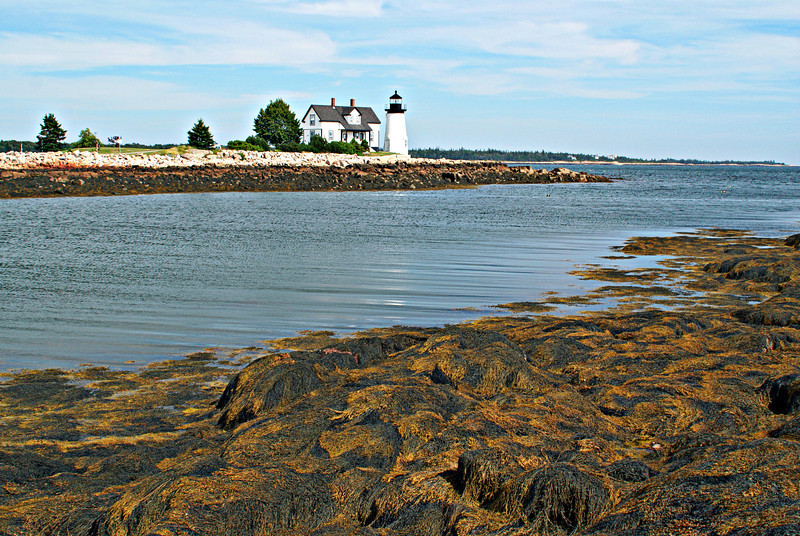 The original lighthouse at Prospect Harbor was a 1½ story granite Keepers house with a granite conical tower attached to its northern end.