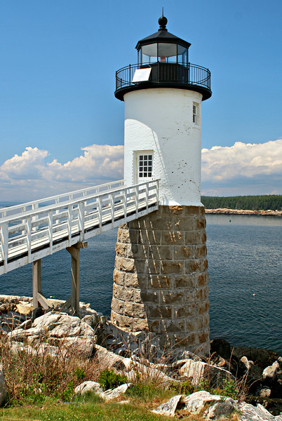 The lighthouse is 40 feet tall and consists of two distinct sections; granite blocks on the lower section support the white brick upper tier.