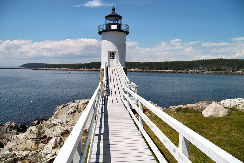 The wooden walkway and tower design is similar to the lights at Marshall Point and Ram Island.