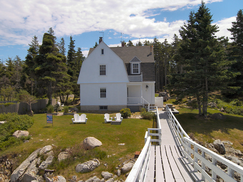 A view from the tower back towards the Keepers House.  The 2 1/2 story dwelling was built in 1907 when the tower was constructed along with the oil house and tool shed.
