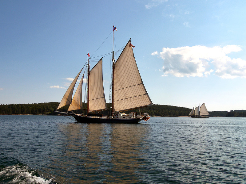 Schooners often sail by the Robinson Point Lighthouse