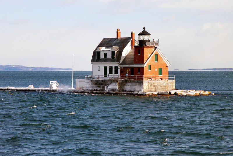 A breakwater was built from Jameson Point out into the bay from 1881 to 1899 to protect shipping from nor'easters.  The builders kept a temporary light hanging on the end of the breakwater as it grew to warn shipping.