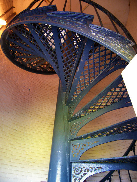 The winding iron stairway up to the lantern room.