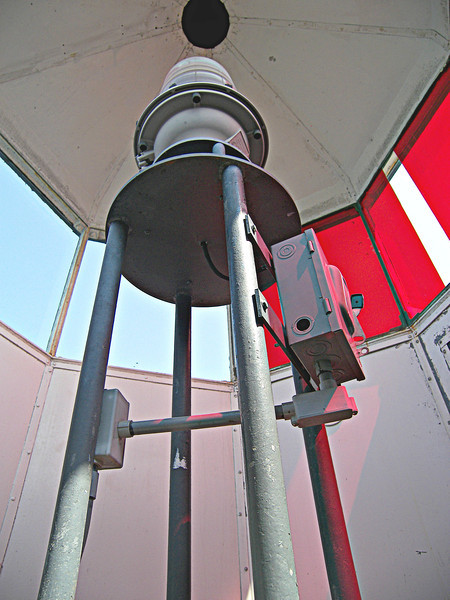 The octagonal lantern room housed a Fifth Order flashing Fresnel lens.  The lens exhibited a white flash every six seconds and had 2 red sectors to warn ships which strayed from the safe shipping channel.