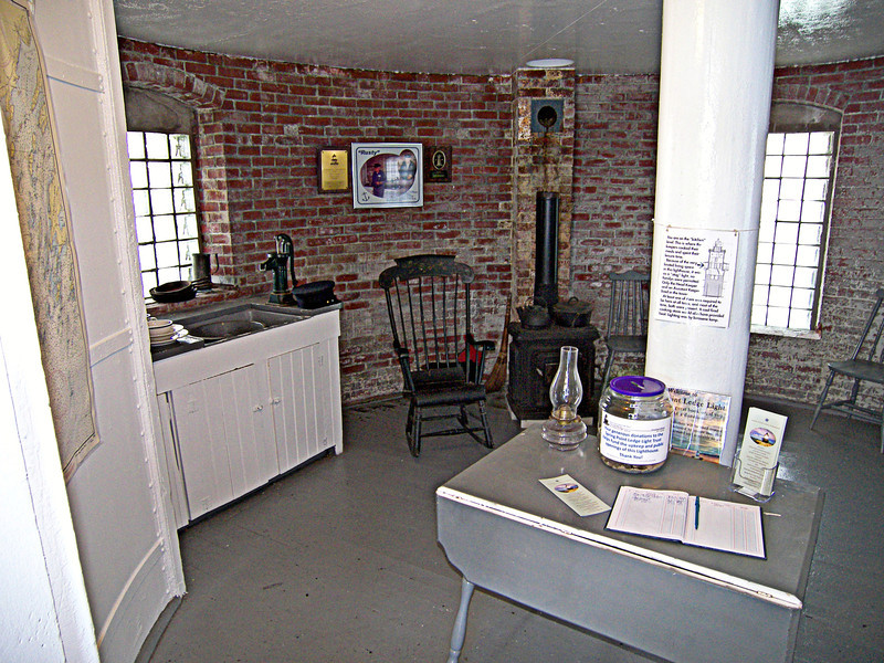 The first floor of the brick tower was a cellar used to store coal and equipment. The next floor contained the kitchen and dining room. A hand pump in the kitchen pulled water from the cisterns located in the foundation.