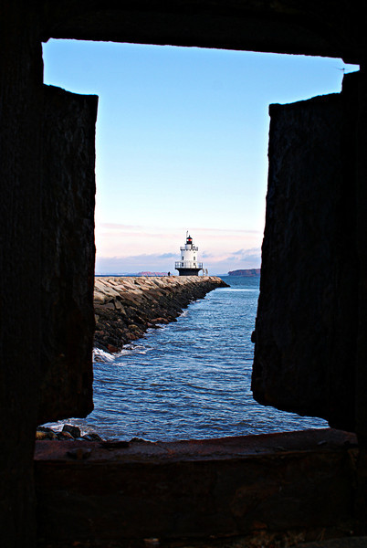 Architect Thomas Dwyer of New York City was selected to prepare plans to build a Fifth Order caisson lighthouse and fog signal on Spring Point Ledge.  The 40 foot iron caisson foundation would be topped with a 3 story brick superstructure with a circular parapet and lantern room.
