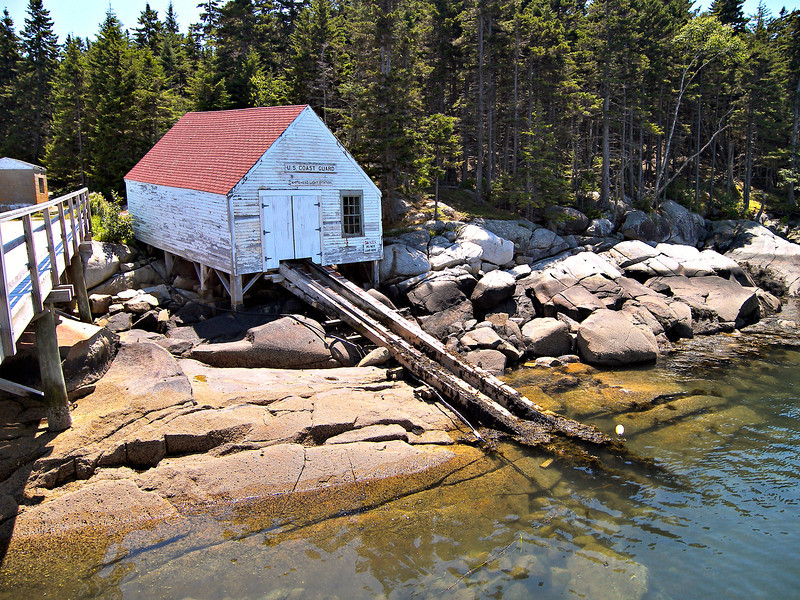 **A view of the old boathouse where you arrive on the island.**  The station was completed in 1807 making it one of the oldest light stations on the Maine coast.