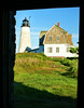 When the new lantern was installed, the lighthouse was automated and all Coast Guard personnel were removed. The island was deeded to the Maine Audubon Society and the island was left to the birds.  This view of the light is taken from inside the Oil House.