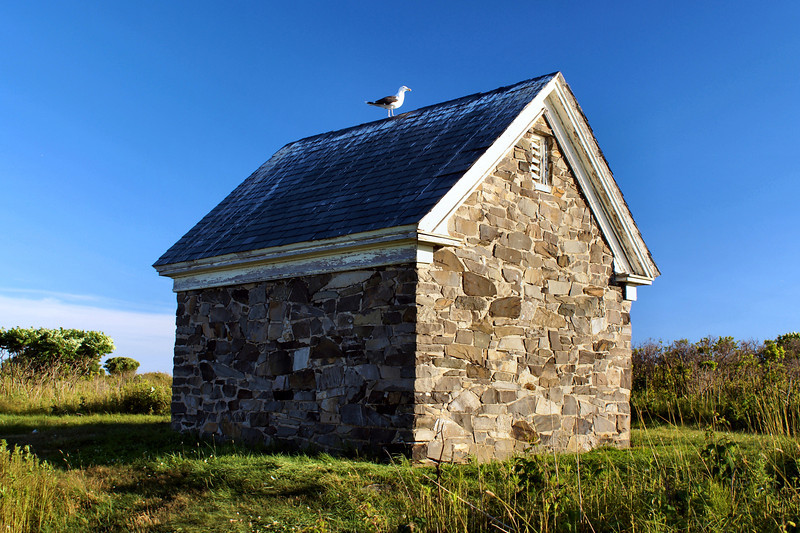 A view of the Wood Island oil house built in 1903. It is interesting as it is constructed of stone rather than brick.