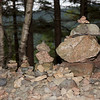 Mini Cairns at Acadia National Park<br /> <br /> Cairns are rock landmarks for hikers in the park to follow the trail. Here is a group of mini cairns on top of a large rock.