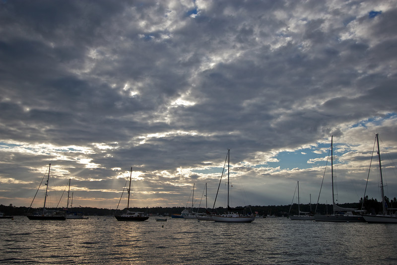 Boothbay Harbor, Maine, August 27, 2012, 6:36 pm<br /> <br /> I caught the sun rays streaming through the clouds before sunset. I didn't do much post production work on this, although it does have an HDR look. Call it a natural HDR.