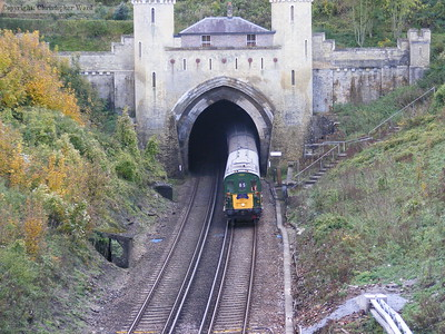 The tour bursts out of the castellated northern portal at Clayton
