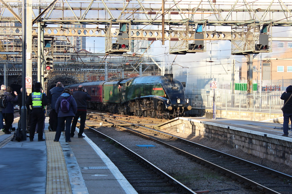 In dappled sunlight, Union of South Africa pulls into platform 1
